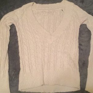 white low cut sweater/throw over